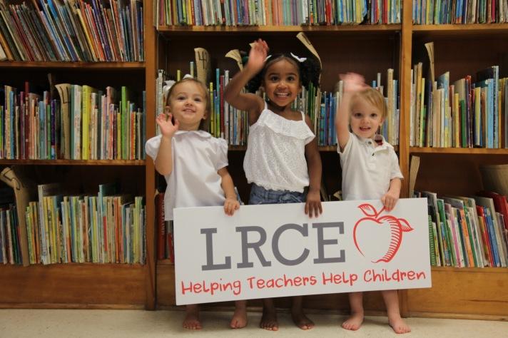 Kids holding lrce logo 2